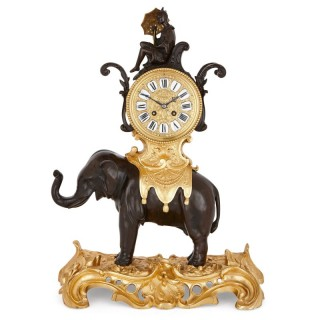 Antique Louis XV style patinated and gilt bronze clock