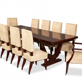 Dominique Attributed, a French Art Deco rosewood dining table and ten suede upholstered chairs