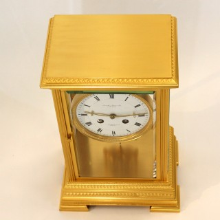 Gilded engraved Four-Glass Mantel Clock