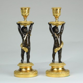 Fine pair of bronze & ormolu putti candlesticks