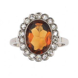 Platinum Ring / Engagement ring with orange coloured Sapphire & Diamonds, from Art déco Netherlands approx. 1930