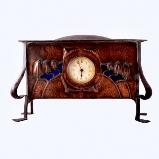 An arts and crafts copper and enamel mantel clock