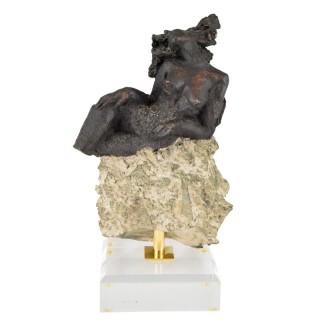 Sculpture nude on a rock