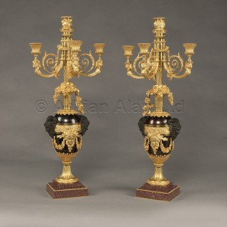 A Pair of Louis XVI Style Patinated and Gilt-Bronze Four-Light Candelabra