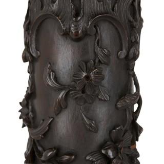 Two antique floral carved wooden pedestals