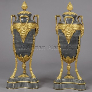 A Pair Of Louis XVI Style Bleu Turquin Marble Urns