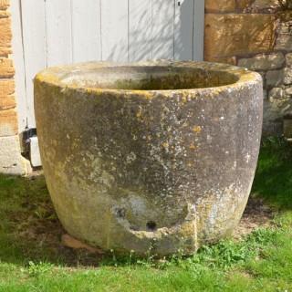 An 18th century circular stone trough