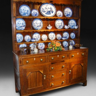 An early 19th century Oak and Inlaid Welsh Dresser