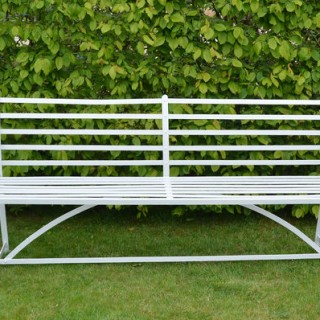 A wrought iron garden bench
