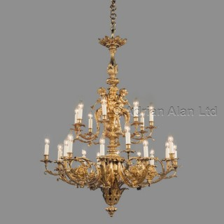 A Louis XVI Style Gilt-Bronze Twenty-Four Light, Two-Tier, Cherub Chandelier