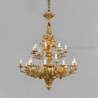 A Louis XVI Style Gilt-Bronze Twenty-Four Light, Two-Tier, Cherub Chandelier
