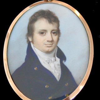 A PORTRAIT MINIATURE OF MATHEW VAUGHAN IN BLUE JACKET