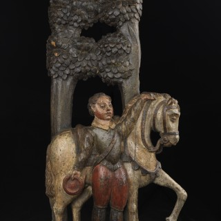 Relief carving of a horse and rider