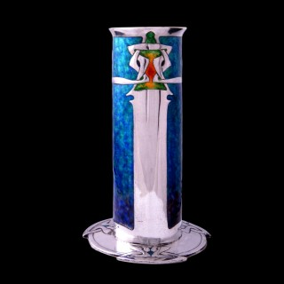 A stunning Archibald Knox Cymric silver and enamelled vase