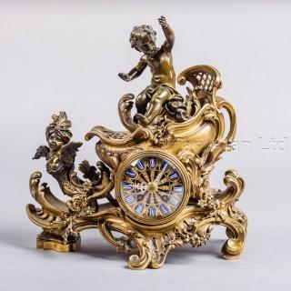 A Rare Gilt and Patinated Bronze 'Chariot' Mantel Clock