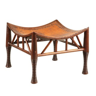 A large scale mahogany Liberty Thebes stool