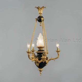 A Louis XVI Style Gilt and Patinated Bronze Four-Light Chandelier