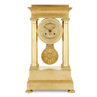 Empire period gilt bronze mantel clock by the Lepaute family