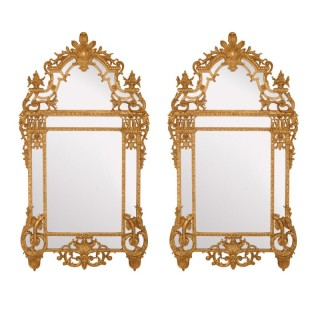 Two large Régence style carved giltwood wall mirrors