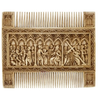 Antique carved ivory double comb with religious scenes