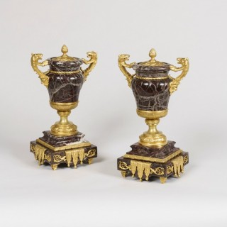 An Emblematic Pair of Ormolu-Mounted Urns