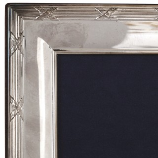 Four silver mounted photo frames by Carrs Silver