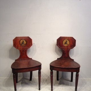 Pair of Georgian mahogany hall chairs.