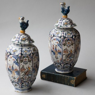 PAIR OF 18TH CENTURY OCTAGONAL RIBBED BALUSTER DELFT POLYCHROME COVERED VASES