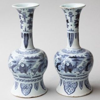 A PAIR OF 17TH CENTURY CHINOISERIE DUTCH DELFT BLUE AND WHITE WAISTED BOTTLE VASES