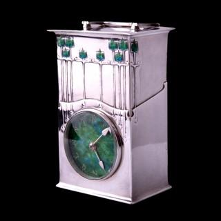 "An Archibald Knox Cymric ""Magnus"" silver clock for Liberty & Co"