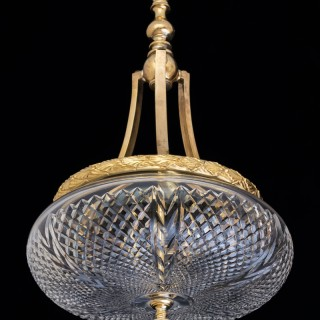 A ORMOLU MOUNTED AND CUT GLASS BOWL LIGHT.