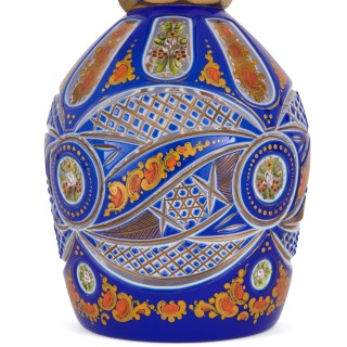 Two Bohemian enamelled blue overlay cut-glass decanters