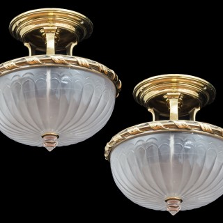 A PAIR OF BRASS AND OPAQUE GLASS BOWL LIGHTS.