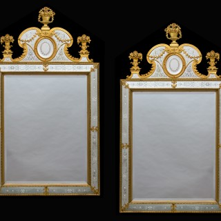 A NEAR PAIR OF VICTORIAN PERIOD ORMOLU MOUNTED AND ENGRAVED MIRRORS
