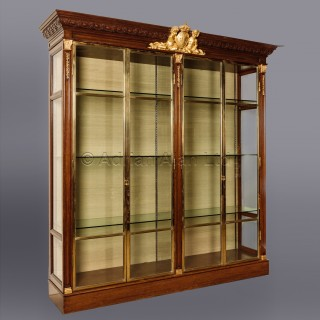 An Oak, Giltwood And Bronze Four Door Grande Vitrine