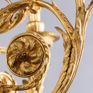 A Louis XVI Style Gilt-Bronze Cherub Twelve-Light Chandelier
