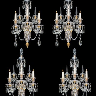 A FINE SET OF FOUR ORMOLU MOUNTED AND CUT GLASS WALL LIGHTS IN THE STYLE OF WILLIAM PARKER
