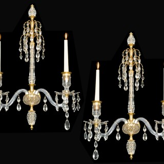 A FINE PAIR OF ORMOLU MOUNTED CUT-GLASS WALL-LIGHTS IN ADAM STYLE