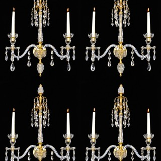 A FINE SET OF FOUR ORMOLU MOUNTED CUT-GLASS WALL-LIGHTS IN ADAM STYLE