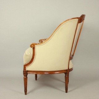 Pair of French Louis XVI Walnut Bèrgères or Armchairs, ca. 1780