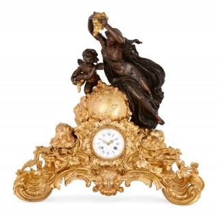 Louis XV style patinated and gilt bronze mantel clock