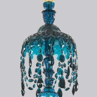 AN EXTREMELY RARE GEORGE III PEACOCK GREEN SIXTEEN LIGHT CHANDELIER ATTRIBUTED TO WILLIAM PARKER