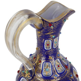 Bohemian parcel gilt and enamelled blue overlay glass jug