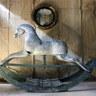 An Early to Mid-Nineteenth Century Grey Bow Rocking Horse c.1830-40