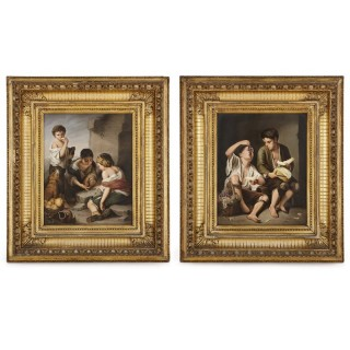 Two KPM porcelain plaques in giltwood frames after Murillo