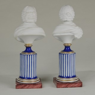 Pair of Niederviller French Bisque figures of Voltaire and Rousseau