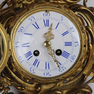 Gilt metal cartel wall clock
