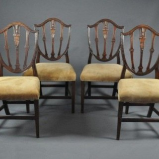 A set of four 18th century Gillows mahogany dining chairs