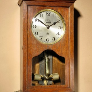 An Early Electrical ATO Haller & Benzing Oak Wall Clock Circa: 1925.