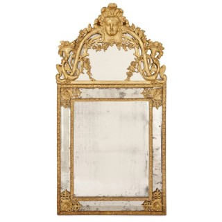 Large Régence period carved giltwood wall mirror